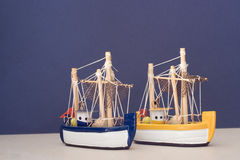 Toy fishing boats. Two toy or model fishing boat for decoration Royalty Free Stock Photography