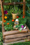Toy with flowers for a well in the yard. Rag toy with flowers for the decoration of a well in the yard Stock Photography