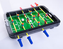 Toy or foosball table on a background. Stock Photos
