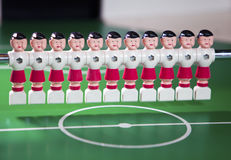 Toy football players  stand in the field in a row Stock Photo