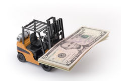 Toy fork lift with 5 dollar Royalty Free Stock Photos