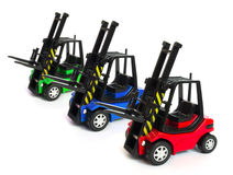 Toy forklifts. Toy electric forklifts isolated on white Stock Photography