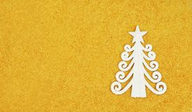 Toy form of a fir tree of white color. On a bright yellow background for a holiday new year and christmas Stock Photos