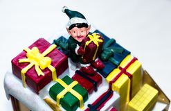 A toy in the form of a little man with a gift in his hands. royalty free stock images