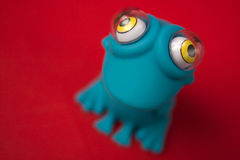 Toy frog. Blue toy rubber frog from above Stock Images