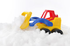 Toy Front Loader Scooping Snow Royalty Free Stock Photography