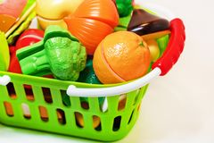 Free Toy Fruits And Vegetables In The Shopping Basket. Healthy Food. A Set Of Toys For The Game In The Shop Stock Images - 134327144
