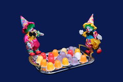 Two happy clowns and candy. Royalty Free Stock Images