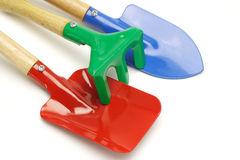 Toy gardening tools. Close up of toy gardening tools on white background Royalty Free Stock Photos