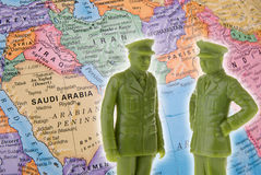 Toy generals and globe focused on the Middle East Royalty Free Stock Photo