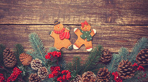 Toy gingerbreads on a wooden table Stock Photography