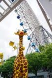 Toy Giraffe under Ferris Wheel Royalty Free Stock Photo