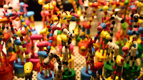 Toy giraffes on display Stock Photos