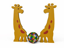 Toy Giraffes with Jigsaw Puzzle Ball Stock Photography
