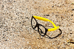 Toy Glasses on Ground Stock Images