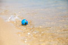 Mini globe on the waves. Toy globe on the crest of a wave shot on a sunny day Stock Images