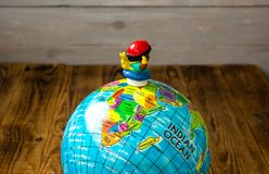 Toy and the globe. A toy and the globe on wooden bsckground Royalty Free Stock Photo