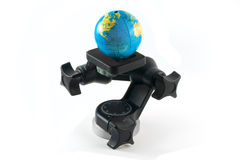 Toy globe on tripods head Stock Photos