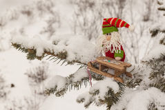 Toy gnome in the tree branch mass produced products Royalty Free Stock Images
