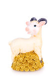 Toy goat with golden coins Stock Photos