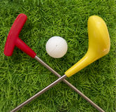 Toy Golf Club with ball on the grass Stock Photo