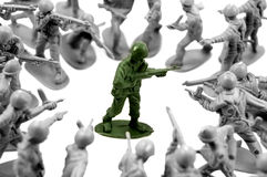 Toy green army man surrounded Royalty Free Stock Photo
