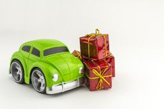 Toy green car with and small gift boxes stock photos