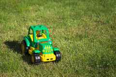 Toy green-yellow tractor Stock Images