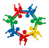 Toy group of people in a circle, in cooperation concept with cli Royalty Free Stock Photo