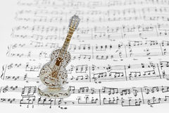 Toy guitar and music sheet Royalty Free Stock Photography
