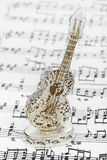 Toy guitar and music sheet Stock Image