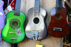 Toy Guitars or ukulele. Three toy guitars or ukuleles at a market stall Stock Images