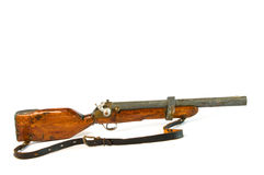 Toy Gun. Old antique toy rifle with white background Stock Photography