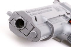 Toy gun. Looking down the barrel of a toy gun Stock Photo