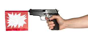 Toy Gun. A hand holding a toy gun with blank banner Royalty Free Stock Images