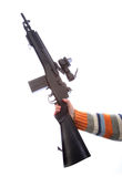 Toy gun. Child's hand holding toy gun in hand against white background Royalty Free Stock Images