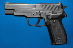 Toy gun (6mm plastic bb), blue version. Nice replica of a p228 Royalty Free Stock Photography
