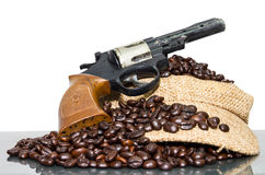 Toy gun coffee beans cap Royalty Free Stock Photography