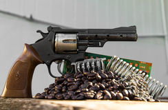 Toy gun coffee beans Royalty Free Stock Photography