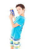Toy gun. Little boy playing with toy gun isolated in white Stock Images