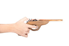 Toy gun made of wood isolated on white background Royalty Free Stock Photos
