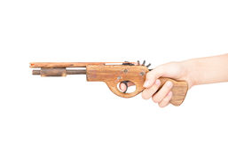 Toy gun made of wood isolated on white background Stock Images