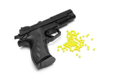Toy gun with pellets isolated Royalty Free Stock Photo