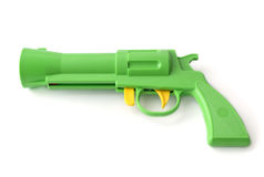 A toy gun on a white background Royalty Free Stock Photo