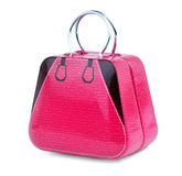 Toy handbag. It is a toy metallic pink small handbag for girls isolated on white background stock images