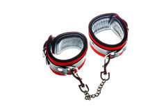 Toy handcuffs. Red leather handcuffs in white background Stock Image