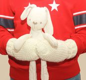 Toy hare in the man hands. Soft selective focus. Tilda stock photos