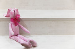Toy hare on a wooden background Royalty Free Stock Image