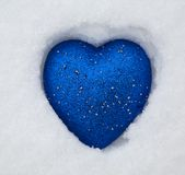 Toy heart. Blue toy heart on the snow royalty free stock images