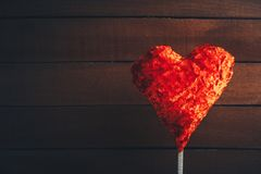Toy heart on dark rustic wooden background. St. Valentine Day symbol of love Royalty Free Stock Photos